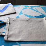 7. Da bo vrečka zašita enakomerno, jo pritrdite z bucikami.